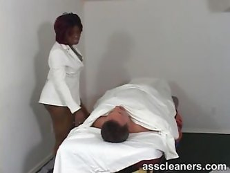 Chubby ebony doctor smothers a complaining...