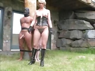 Nasty mistress ties-up her slaves to a...