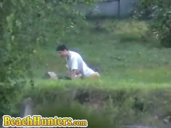 Horny couple having sex on grass caught on...