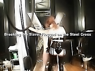 The Dominatrix Caresses Her Slav...