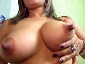 Horny chick plays with her big boobs...